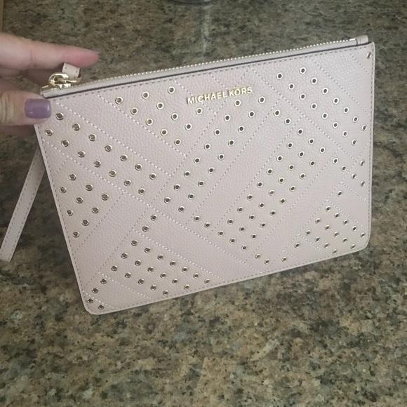 Michael Kors Handbags - NWT Michael Kors Large wristlet pink with gold